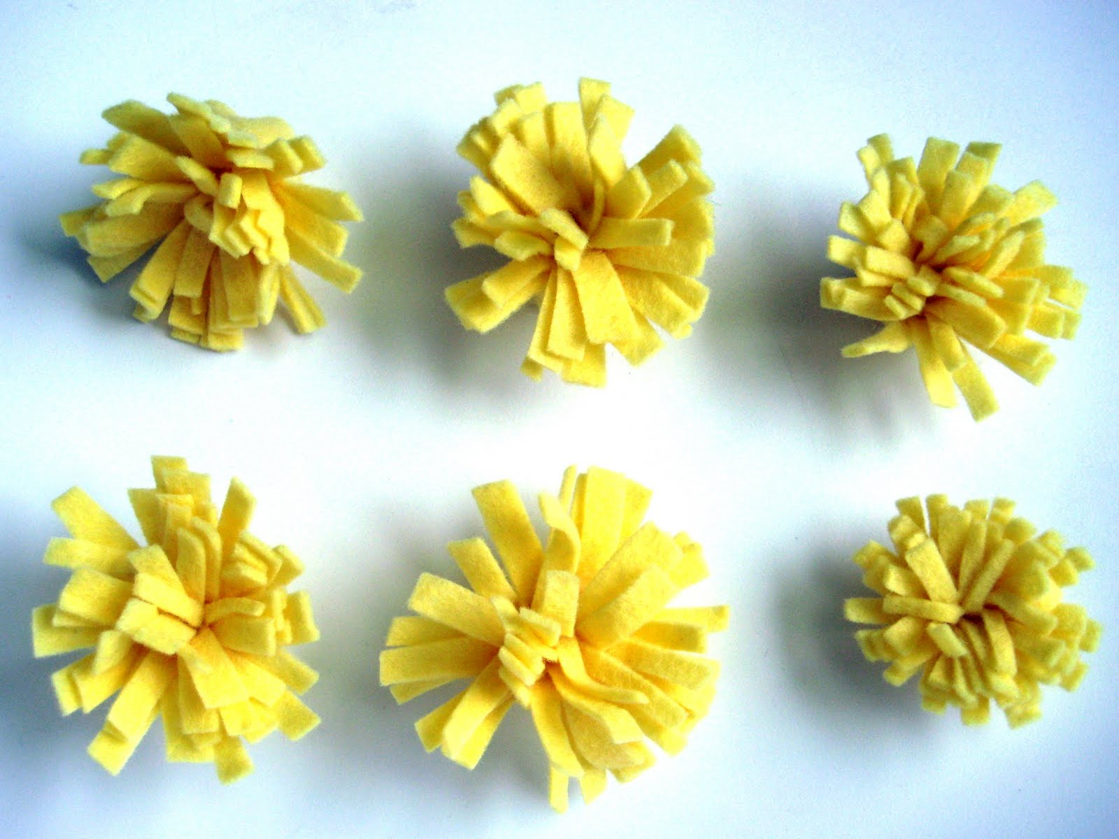 Craft 81 diy felt flowers craft i recently showed you how i made crepe paper flowers welp i have moved on to felt flower making is fun yall mightylinksfo