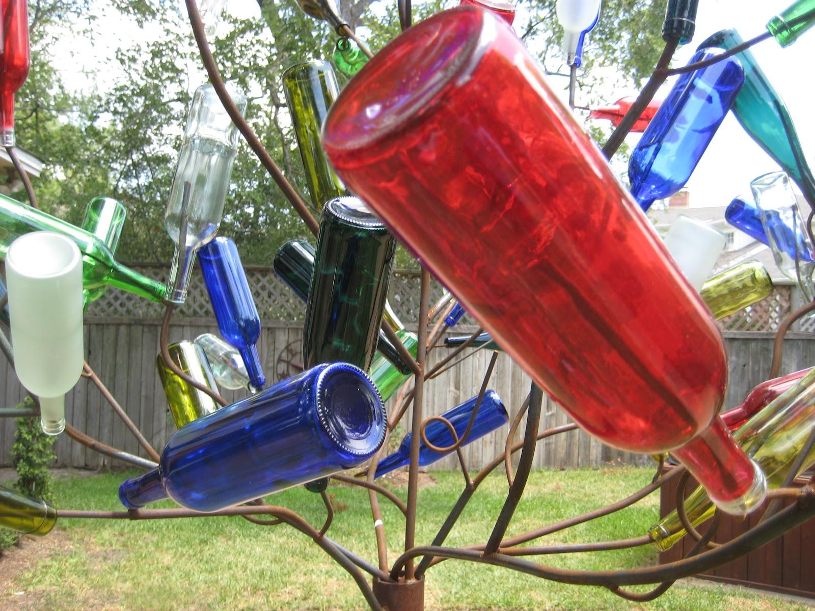 Wine bottle crafts outdoor - Diy Bottle Tree Diy Garden Projects