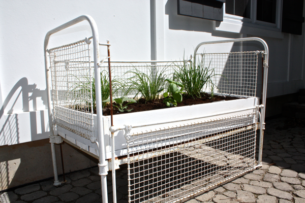 Upcycle an old crib into an herb garden