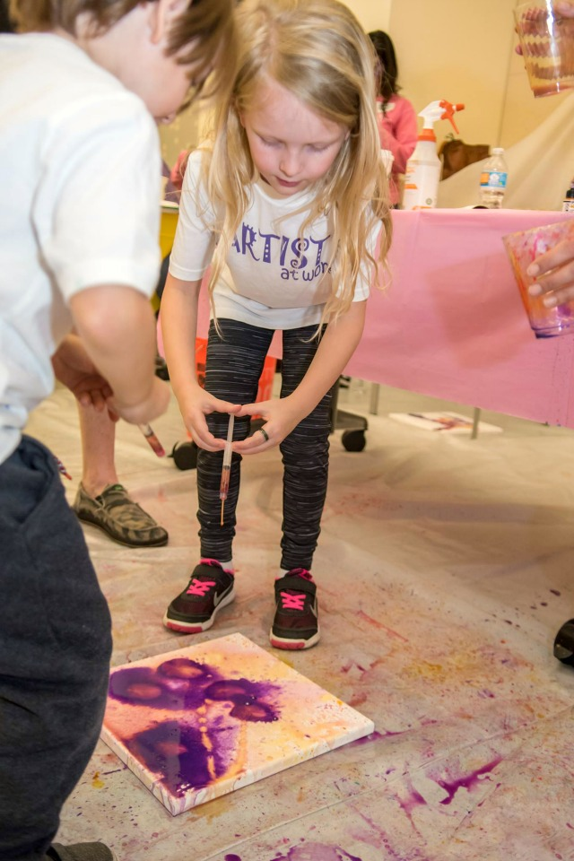 Collaborative spray bottle art with tons of kids