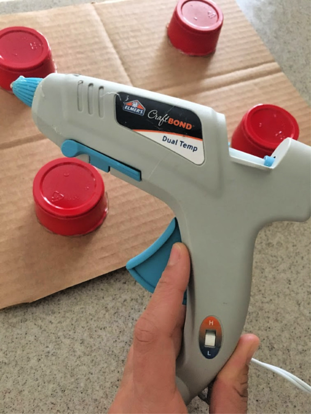 Dual temperature hot glue gun