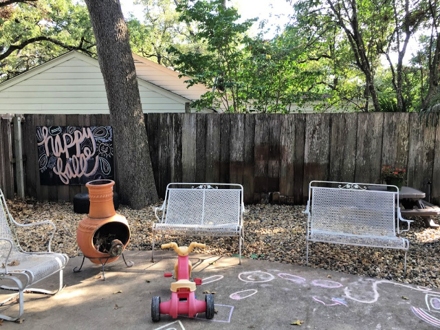 backyard patio with DIY chalkboard